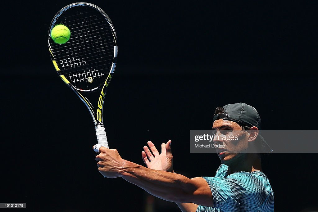 <a gi-track='captionPersonalityLinkClicked' href=/galleries/search?phrase=Rafael+Nadal&family=editorial&specificpeople=194996 ng-click='$event.stopPropagation()'>Rafael Nadal</a> of Spain hits a backhand volley during a practice session ahead of the 2014 Australian Open at Melbourne Park on January 8, 2014 in Melbourne, Australia.