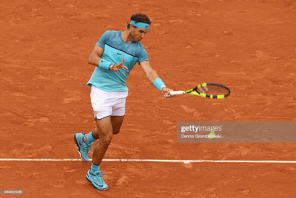 Rafael Nadal of Spain hits a forehand during the Men's Singles first round match against Sam Groth of Australia on day three of the 2016 French Open at Roland Garros on May 24, 2016 in Paris, France.