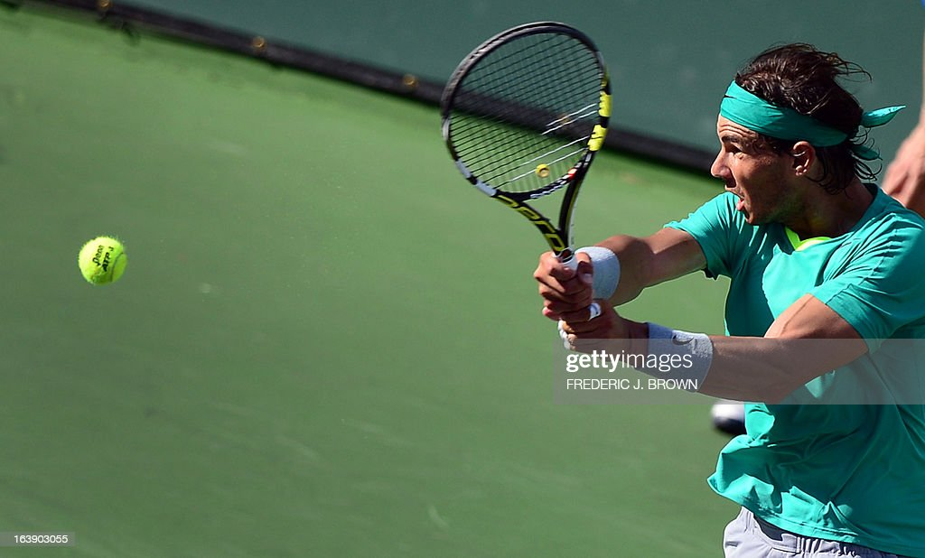 Rafael Nadal of Spain hits a forehand return against Juan Martin Del Potro of Argentina on March 17, 2013 in Indian Wells, California, in the men's tennis final at the BNP Paribas Open. AFP PHOTO/Frederic J. BROWN
