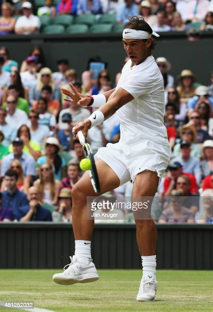 Rafael Nadal of Spain hits a forehand return during his Gentlemen's Singles second round match against Lukas Rosol of Czech Republic on day four of...