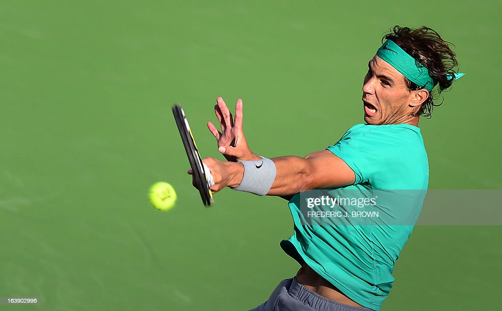 Rafael Nadal of Spain hits a forehand return to Juan Martin Del Potro of Argentina on March 17, 2013 in Indian Wells, California, in the men's tennis final at the BNP Paribas Open. AFP PHOTO/Frederic J. BROWN