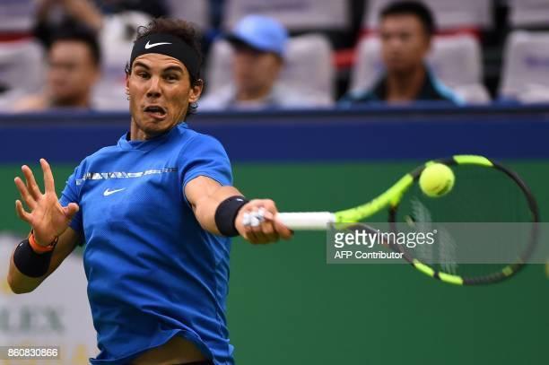 Rafael Nadal of Spain hits a return against Grigor Dimitrov of Bulgaria during their men's singles quarterfinal match at the Shanghai Masters tennis...
