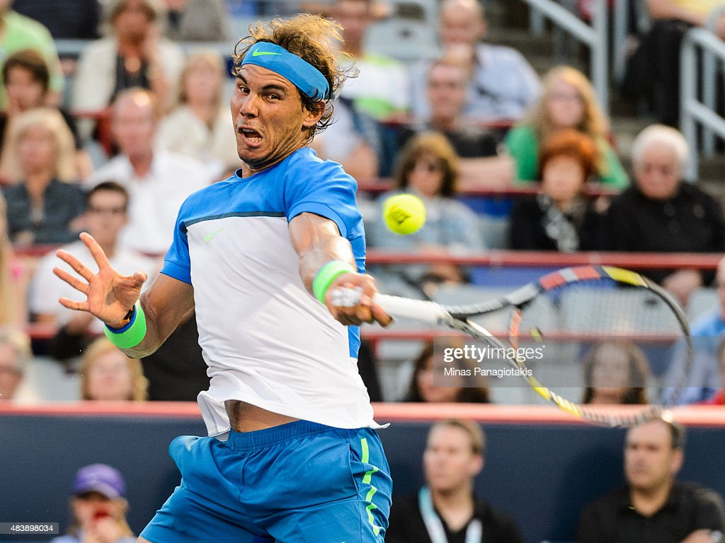 Rafael Nadal of Spain hits a return against Mikhail Youzhny of Russia during day four of the Rogers Cup at Uniprix Stadium on August 13 2015 in...