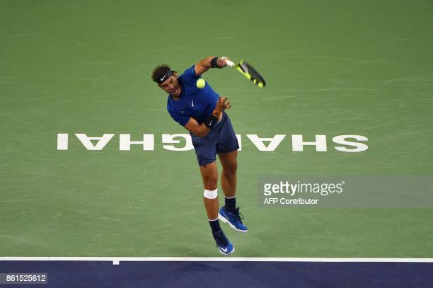 Rafael Nadal of Spain hits a return against Roger Federer of Switzerland during their men's singles final match at the Shanghai Masters tennis...