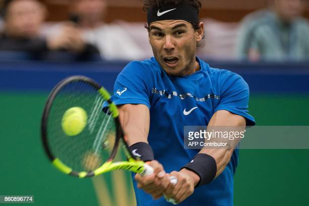 Rafael Nadal of Spain hits a return during his men's quarterfinals singles match against Grigor Dimitrov of Bulgaria at the Shanghai Masters tennis...