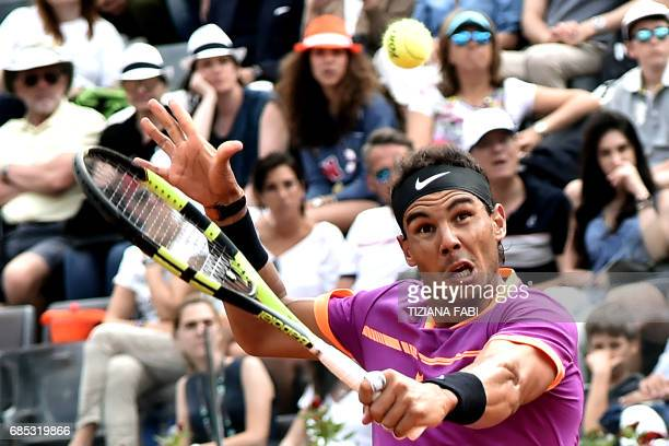 Rafael Nadal of Spain hits a return to Dominic Thiem of Austria during their quarterfinal tennis match at the ATP Tennis Open tournament on May 19...