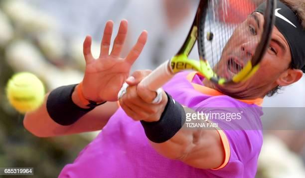 TOPSHOT Rafael Nadal of Spain hits a return to Dominic Thiem of Austria during their quarterfinal tennis match at the ATP Tennis Open tournament on...