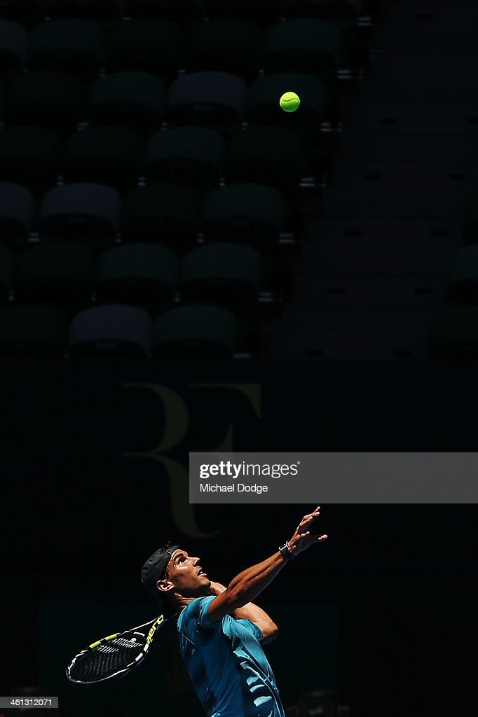 <a gi-track='captionPersonalityLinkClicked' href=/galleries/search?phrase=Rafael+Nadal&family=editorial&specificpeople=194996 ng-click='$event.stopPropagation()'>Rafael Nadal</a> of Spain hits a serve during a practice session ahead of the 2014 Australian Open at Melbourne Park on January 8, 2014 in Melbourne, Australia.