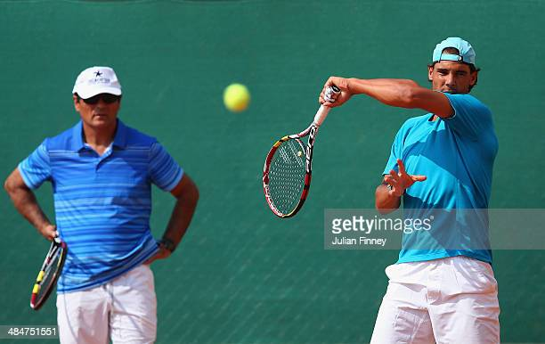 Rafael Nadal of Spain hits in a practice session as uncle/coach Toni Nadal watches on during day two of the ATP Monte Carlo Rolex Masters Tennis at...