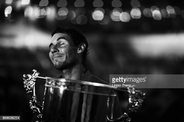 Rafael Nadal of Spain hold the winners trophy poses for a picture after winning the Men's Singles final against Nick Kyrgios of Australia on day nine...