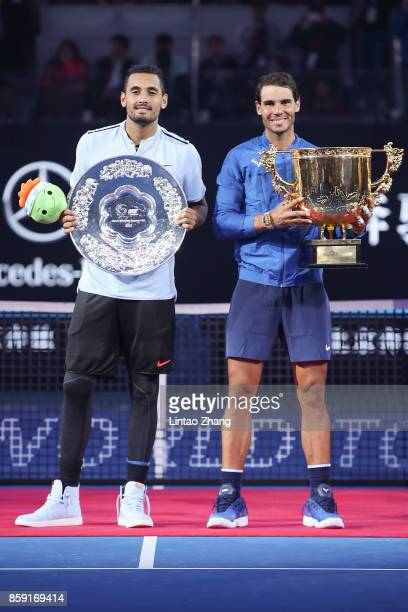 Rafael Nadal of Spain holding the winners trophy with Nick Kyrgios of Australia poses for a picture after winning the Men's Singles final on day nine...