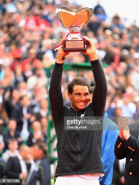 Rafael Nadal of Spain holds aloft his winners trophy after his straight set victory against Albert RamosVinolas of Spain in the final on day eight of...