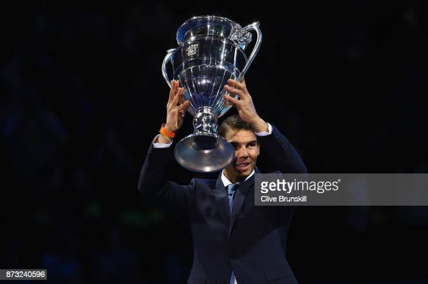 Rafael Nadal of Spain holds aloft the Emirates ATP year end World Number One trophy after a presentation to him on the first day of the Nitto ATP...
