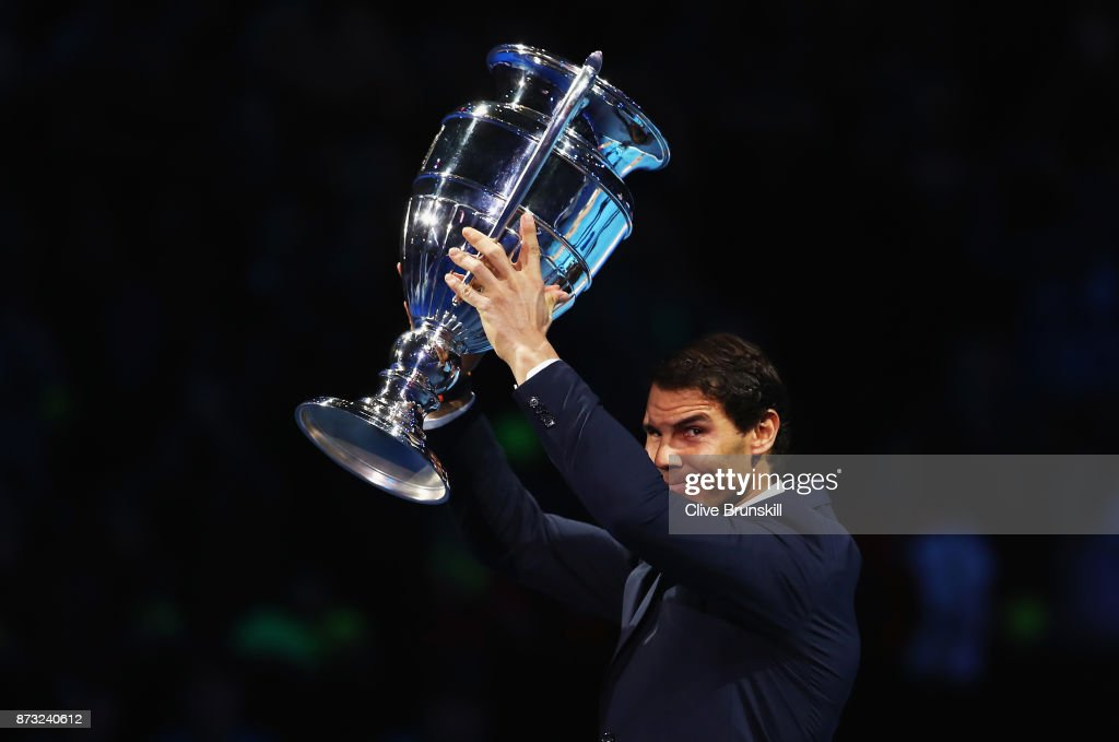Rafael Nadal of Spain holds aloft the Emirates ATP year end World Number One trophy after a presentation to him on the first day of the Nitto ATP World Tour Finals at O2 Arena on November 12, 2017 in London, England.