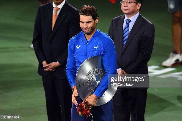 Rafael Nadal of Spain holds his trophy after losing the men's singles final match to Roger Federer of Switzerland at the Shanghai Masters tennis...