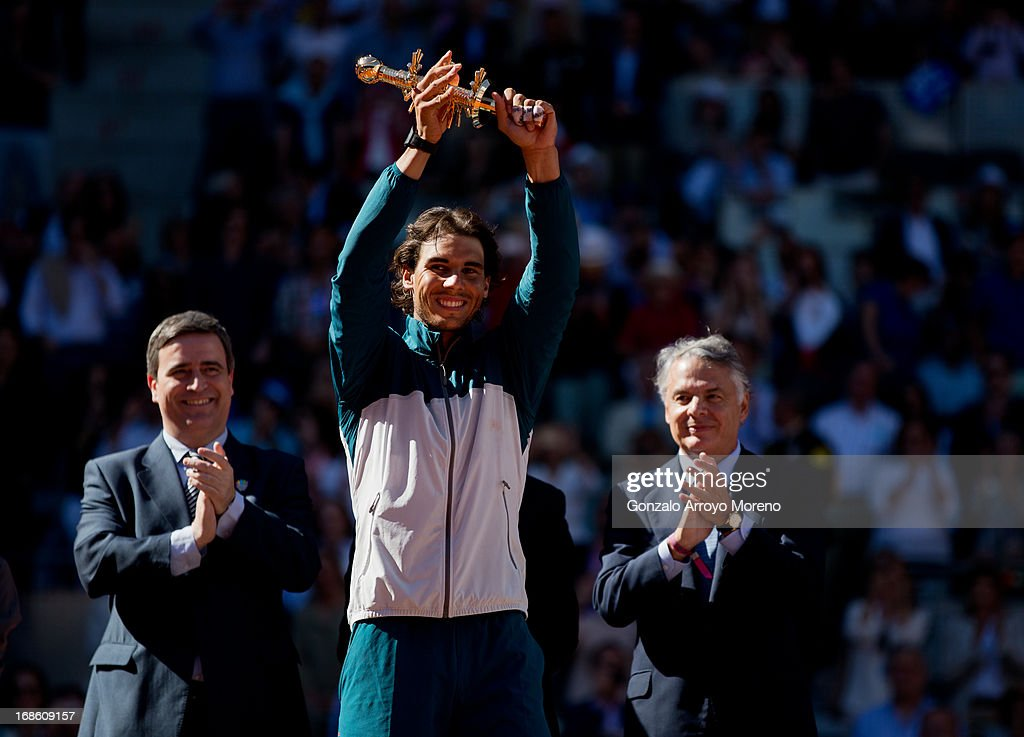 <a gi-track='captionPersonalityLinkClicked' href=/galleries/search?phrase=Rafael+Nadal&family=editorial&specificpeople=194996 ng-click='$event.stopPropagation()'>Rafael Nadal</a> of Spain holds his trophy aloft after winning his final match against Stanislas Wawrinka of Switzerland on day nine of the Mutua Madrid Open tennis tournament at the Caja Magica on May 12, 2013 in Madrid, Spain.