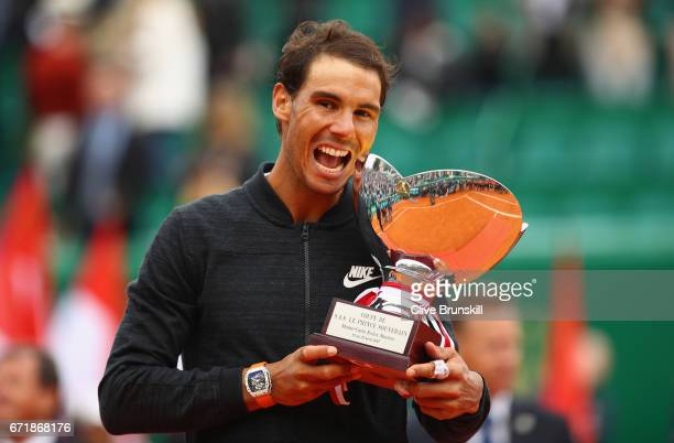 Rafael Nadal of Spain holds his winners trophy after his straight set victory against Albert RamosVinolas of Spain in the final on day eight of the...