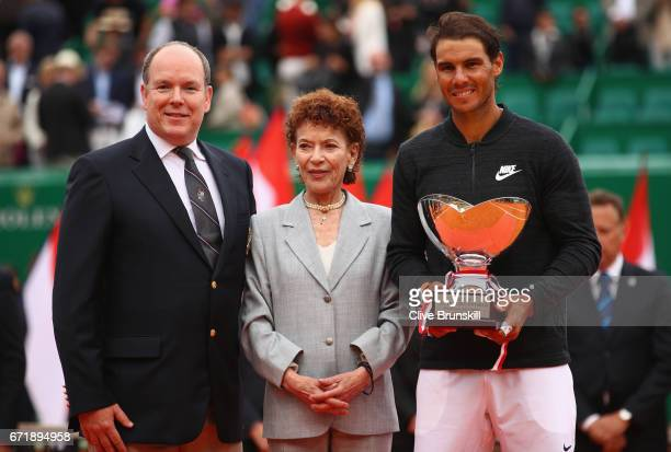 Rafael Nadal of Spain holds his winners trophy alongside Prince Albert ll of Monaco and Elisabeth Anne de Massy President of the Monegasque Tennis...
