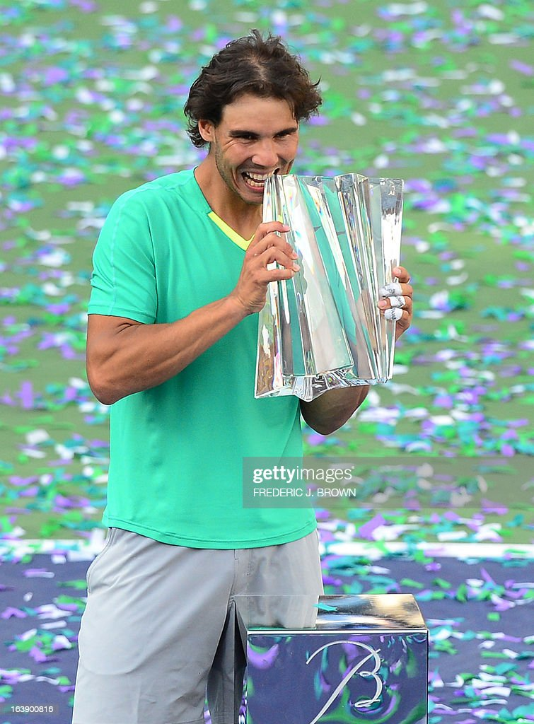 Rafael Nadal of Spain holds the championship trophy after defeating Juan Martin Del Potro of Argentina in three-sets on March 17, 2013 in Indian Wells, California, in the men's tennis final at the BNP Paribas Open. AFP PHOTO/Frederic J. BROWN