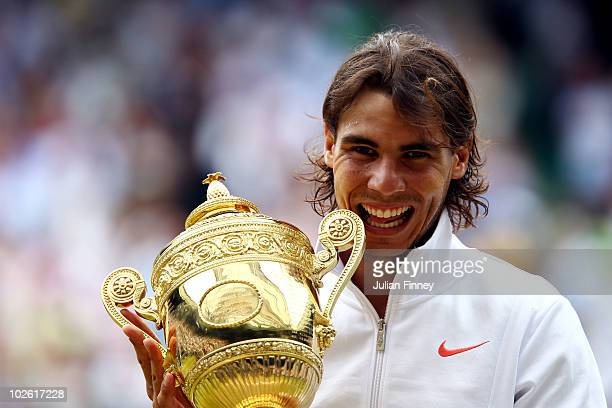 Rafael Nadal of Spain holds the Championship trophy after winning the Men's Singles Final match against Tomas Berdych of Czech Republic on Day...