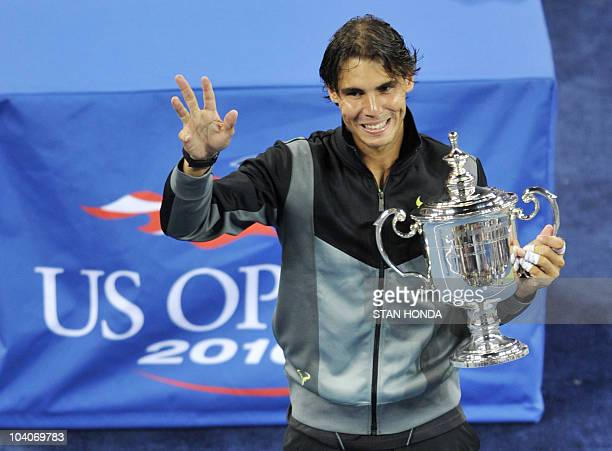 Rafael Nadal of Spain holds the championship trophy as he celebrates his 64 57 64 62 win over Novak Djokovic of Serbia in the Men's Finals at the US...