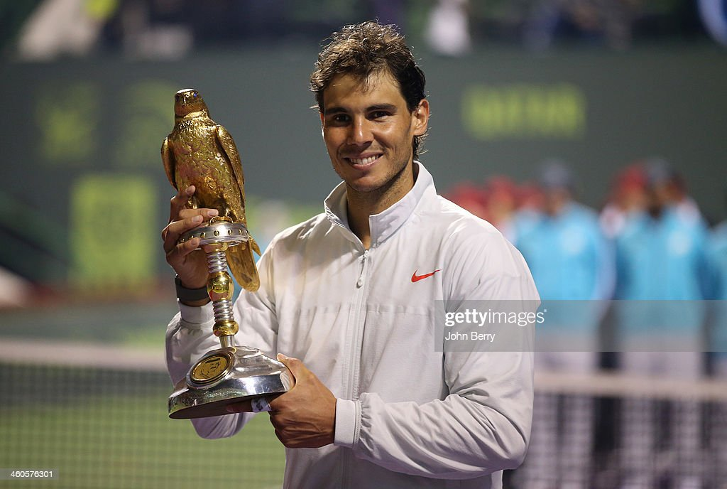 Rafael Nadal of Spain holds the trophy after beating Gael Monfils of France in the final of the Qatar ExxonMobil Open 2014 held at the Khalifa...