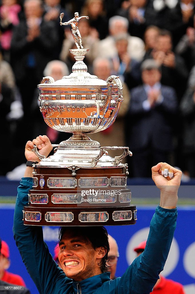 <a gi-track='captionPersonalityLinkClicked' href=/galleries/search?phrase=Rafael+Nadal&family=editorial&specificpeople=194996 ng-click='$event.stopPropagation()'>Rafael Nadal</a> of Spain holds the trophy after winning his final match againts Nicolas Almagro of Spain during day seven of the 2013 Barcelona Open Banc Sabadell on April 28, 2013 in Barcelona. <a gi-track='captionPersonalityLinkClicked' href=/galleries/search?phrase=Rafael+Nadal&family=editorial&specificpeople=194996 ng-click='$event.stopPropagation()'>Rafael Nadal</a> won 6-4, 6-3.