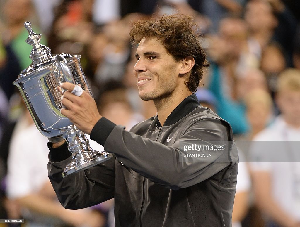 Rafael Nadal of Spain holds the trophy as he celebrates his win over Novak Djokovic of Serbia during their 2013 US Open men's singles final match at the USTA Billie Jean King National Tennis Center September 9, 2013 in New York. AFP PHOTO/Stan HONDA