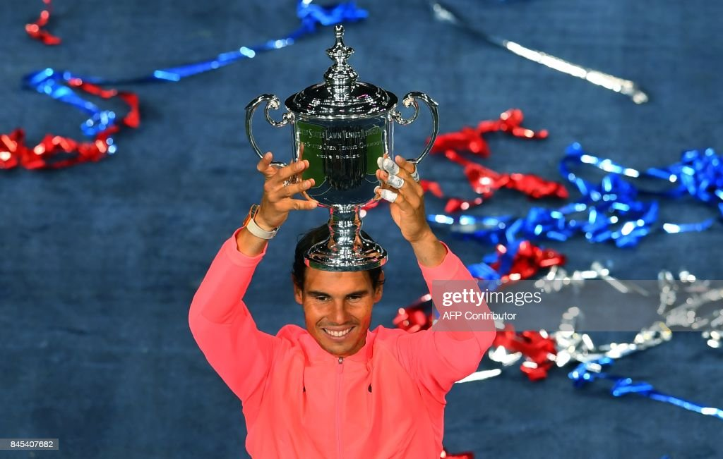 TOPSHOT - Rafael Nadal of Spain holds the US Open trophy after defeating Kevin Anderson of South Africa in their US Open Men's Singles Final match Septmber 10, 2017 at the Billie Jean King Stadium National Tennis Center in New York. /