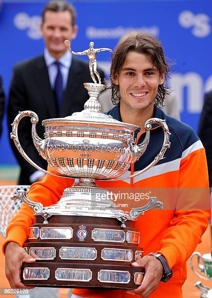 Rafael Nadal of Spain holds the winners trophy after his match against his fellow countryman David Ferrer on day seven of the ATP 500 World Tour...