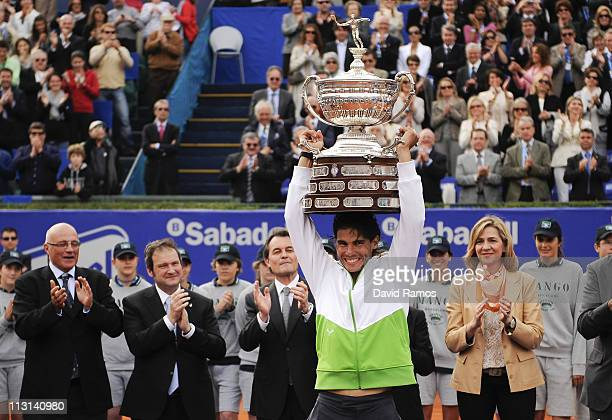 Rafael Nadal of Spain holds up the trophy after beating David Ferrer during the final match on day seven of the ATP 500 World Tour Barcelona Open...