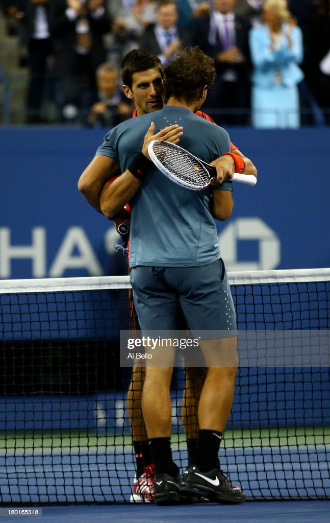 <a gi-track='captionPersonalityLinkClicked' href=/galleries/search?phrase=Rafael+Nadal&family=editorial&specificpeople=194996 ng-click='$event.stopPropagation()'>Rafael Nadal</a> of Spain hugs <a gi-track='captionPersonalityLinkClicked' href=/galleries/search?phrase=Novak+Djokovic&family=editorial&specificpeople=588315 ng-click='$event.stopPropagation()'>Novak Djokovic</a> of Serbia at the net after their men's singles final match on Day Fifteen of the 2013 US Open at the USTA Billie Jean King National Tennis Center on September 9, 2013 in the Flushing neighborhood of the Queens borough of New York City.