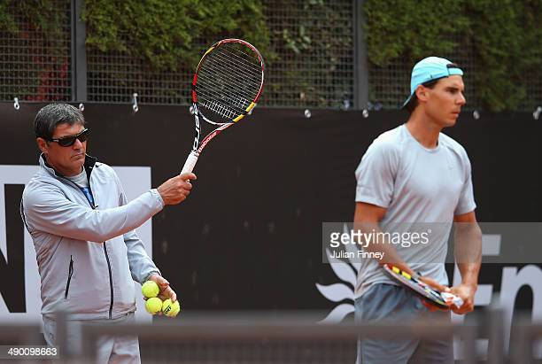 Rafael Nadal of Spain in a practice session as coach and uncle Toni Nadal watches on during day three of the Internazionali BNL d'Italia tennis 2014...