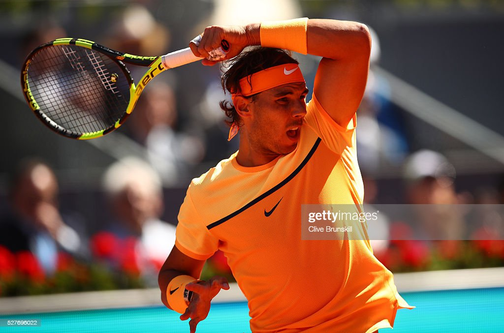 <a gi-track='captionPersonalityLinkClicked' href=/galleries/search?phrase=Rafael+Nadal&family=editorial&specificpeople=194996 ng-click='$event.stopPropagation()'>Rafael Nadal</a> of Spain in action against Andrey Kuznetsov of Russia in their second round match during day four of the Mutua Madrid Open tennis tournament at the Caja Magica on May 03, 2016 in Madrid,Spain.