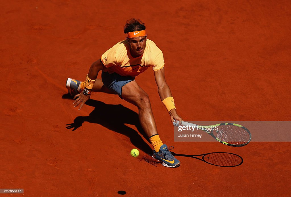 <a gi-track='captionPersonalityLinkClicked' href=/galleries/search?phrase=Rafael+Nadal&family=editorial&specificpeople=194996 ng-click='$event.stopPropagation()'>Rafael Nadal</a> of Spain in action against Andrey Kuznetsov of Russia during day four of the Mutua Madrid Open tennis tournament at the Caja Magica on May 03, 2016 in Madrid, Spain.