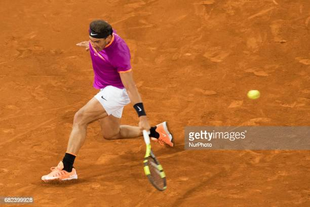 Rafael Nadal of Spain in action against David Goffin of Belgium during day seven of the Mutua Madrid Open tennis at La Caja Magica on May 12 2017 in...