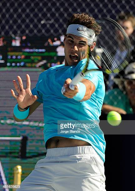 Rafael Nadal of Spain in action against David Nalbandian of Argentina during a exhibition match at La Rural stadium on November 23 2010 in Buenos...