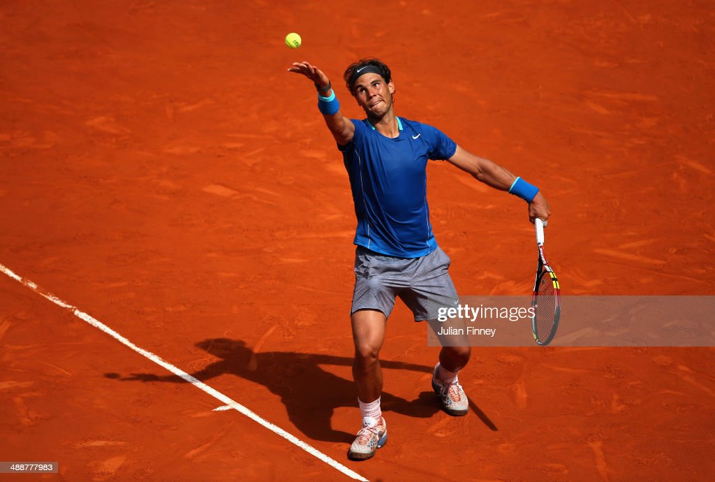 <a gi-track='captionPersonalityLinkClicked' href=/galleries/search?phrase=Rafael+Nadal&family=editorial&specificpeople=194996 ng-click='$event.stopPropagation()'>Rafael Nadal</a> of Spain in action against <a gi-track='captionPersonalityLinkClicked' href=/galleries/search?phrase=Jarkko+Nieminen&family=editorial&specificpeople=211396 ng-click='$event.stopPropagation()'>Jarkko Nieminen</a> of Finland during day six of the Mutua Madrid Open tennis tournament at the Caja Magica on May 8, 2014 in Madrid, Spain.