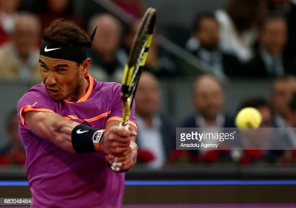 Rafael Nadal of Spain in action against Nick Kyrgios of Australia during the ATP Masters 1000 Open men's tennis match within the Mutua Madrid Open at...