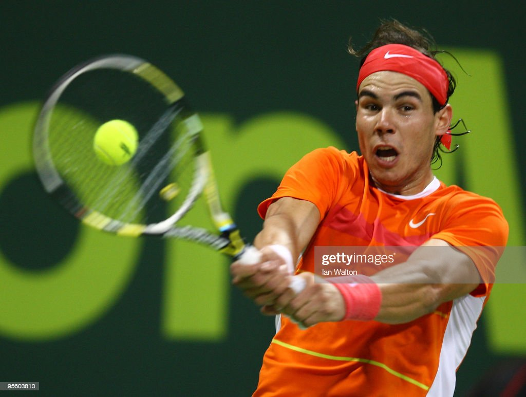 Rafael Nadal of Spain in action against Potito Starace of Italy during the 2nd round of the ATP Qatar ExxonMobil Open at the Khalifa International...