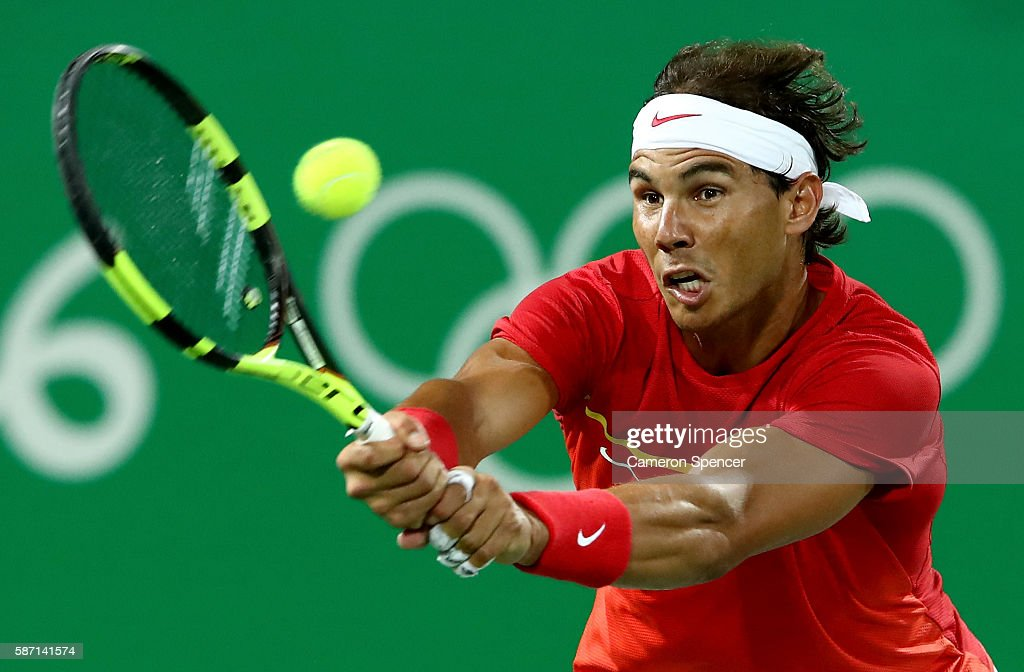 Rafael Nadal of Spain in action against Robin Haase and Jean-Julien Rojer of Holland in their doubles match on Day 2 of the Rio 2016 Olympic Games at the Olympic Tennis Centre on August 7, 2016 in Rio de Janeiro, Brazil.
