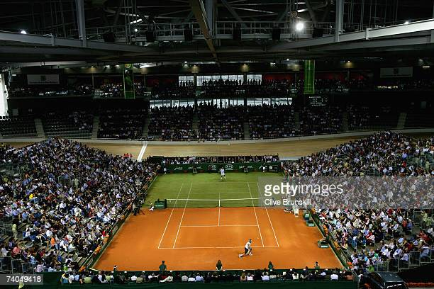 Rafael Nadal of Spain in action against Roger Federer of Switzerland during the 'The Battle of the Surfaces' at The Palma Arena on May 2 2007 in...