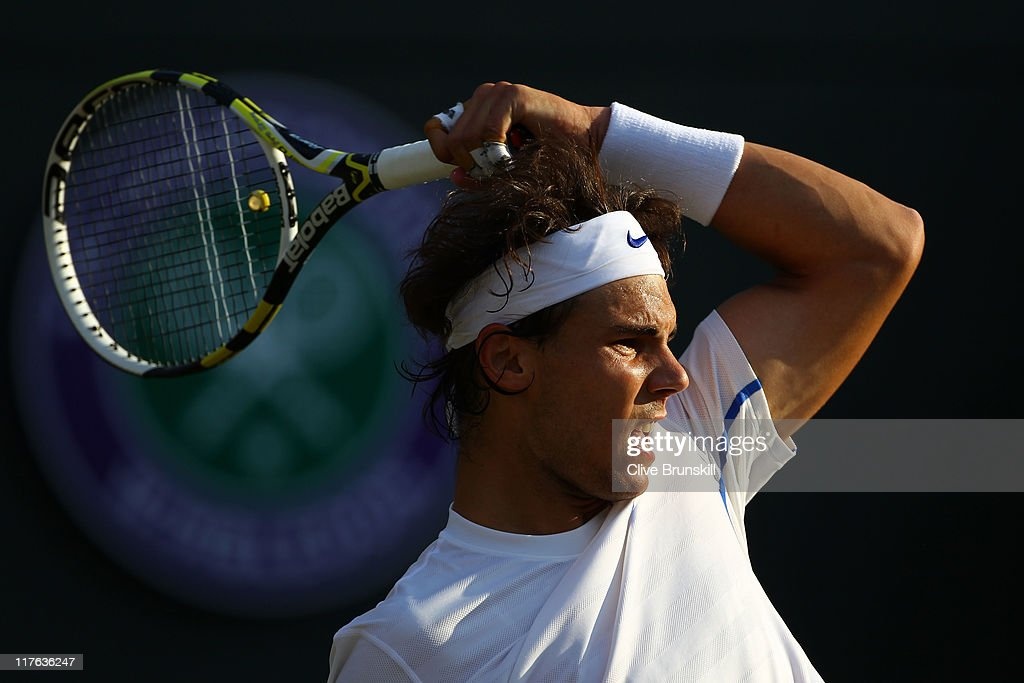<a gi-track='captionPersonalityLinkClicked' href=/galleries/search?phrase=Rafael+Nadal&family=editorial&specificpeople=194996 ng-click='$event.stopPropagation()'>Rafael Nadal</a> of Spain in action during his quaterfinal round match against Mardy Fish of the United States on Day Nine of the Wimbledon Lawn Tennis Championships at the All England Lawn Tennis and Croquet Club on June 29, 2011 in London, England.