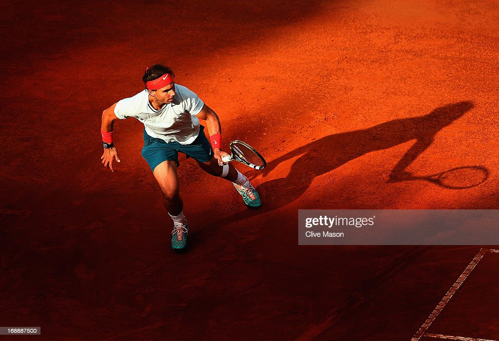<a gi-track='captionPersonalityLinkClicked' href=/galleries/search?phrase=Rafael+Nadal&family=editorial&specificpeople=194996 ng-click='$event.stopPropagation()'>Rafael Nadal</a> of Spain in action during his third round match against Ernests Gulbis of Latvia on day five of the Internazionali BNL d'Italia 2013 at the Foro Italico Tennis Centre on May 16, 2013 in Rome, Italy.
