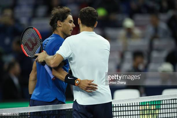 Rafael Nadal of Spain is congratulated by Grigor Dimitrov of Bulgaria after winning the Men's singles quarter final mach on day six of 2017 ATP...