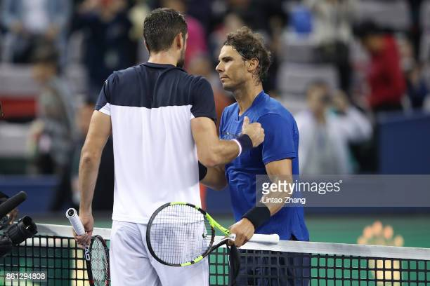 Rafael Nadal of Spain is congratulated by Marin Cilic of Croatia after winning the Men's singles Semifinal mach on day seven of 2017 ATP Shanghai...