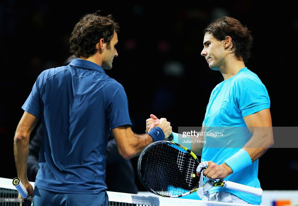 Rafael Nadal of Spain is congratulated by Roger Federer of Switzerland after their men's singles semi-final match during day seven of the Barclays ATP World Tour Finals at O2 Arena on November 10, 2013 in London, England.