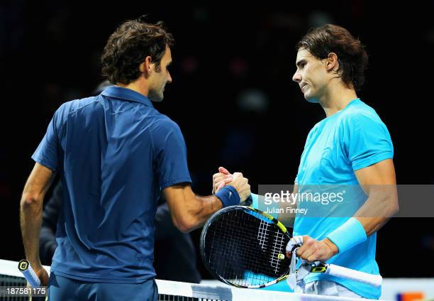 Rafael Nadal of Spain is congratulated by Roger Federer of Switzerland after their men's singles semifinal match during day seven of the Barclays ATP...