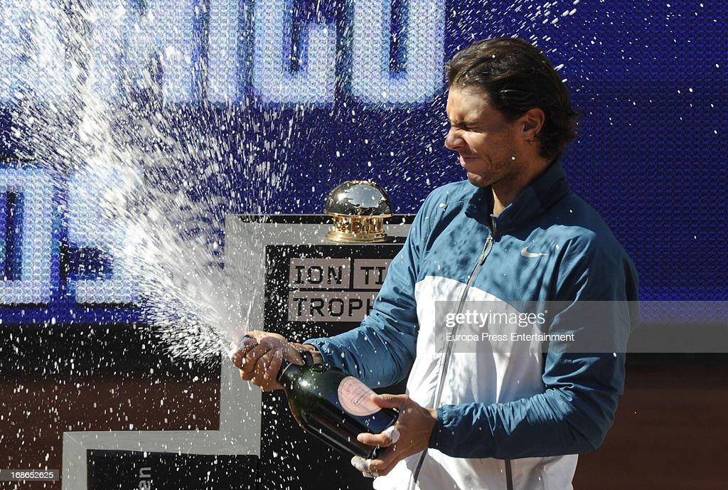 Rafael Nadal of Spain is covered in champagne celebrating his win over Stanislas Wawrinka of Switzerland after the final match during the Mutua Madrid Open tennis tournament at La Caja Magica on May 12, 2013 in Madrid, Spain.