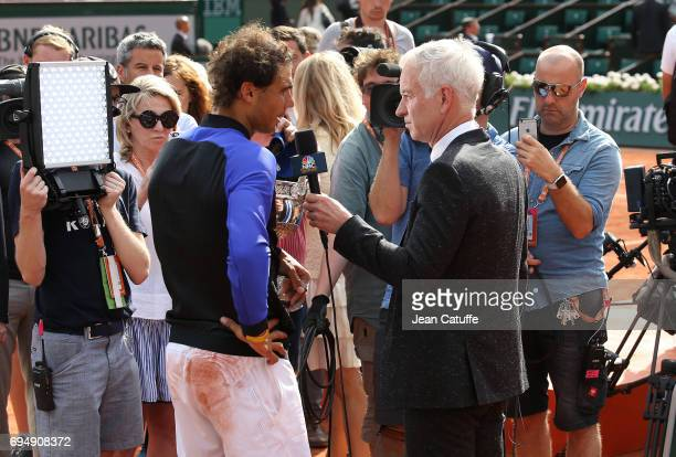 Rafael Nadal of Spain is interviewed by John McEnroe following the men's final on day 15 of the 2017 French Open second Grand Slam of the season at...